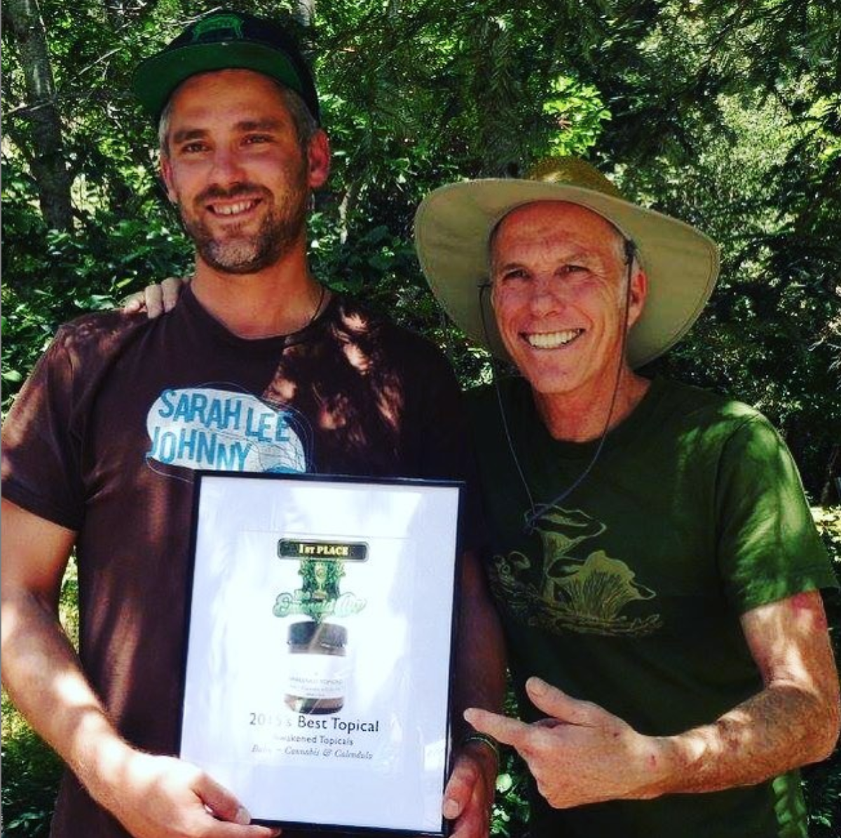 Levi Strom (pictured left) with Emerald Cup founder Tim Blake. Awakened Topicals  Raw Cannabis Balm  placed first at the Emerald Cup in the topicals category in 2015.