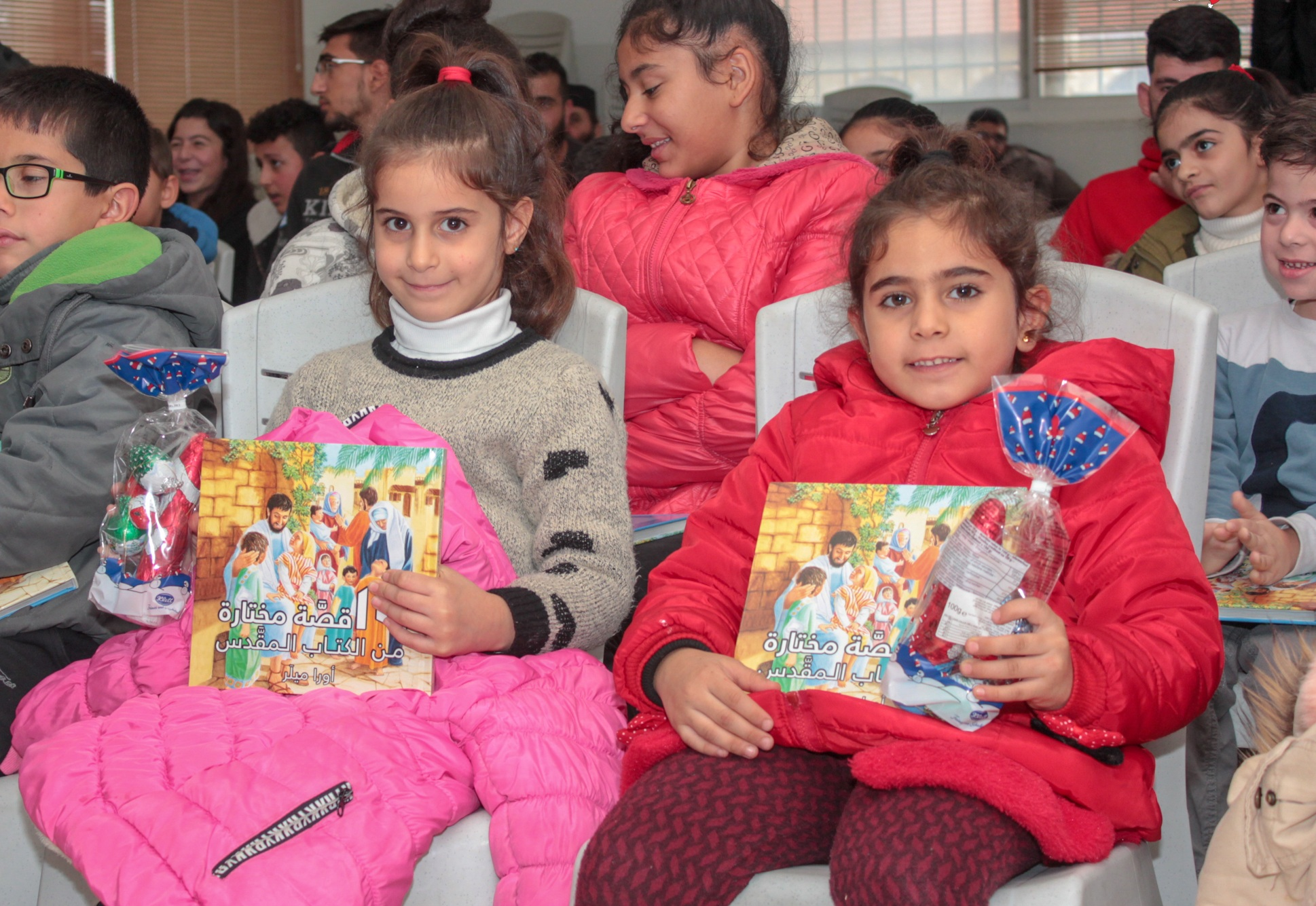 Children+with+their+Bible+book+and+a+gift+at+one+of+our+events.jpg