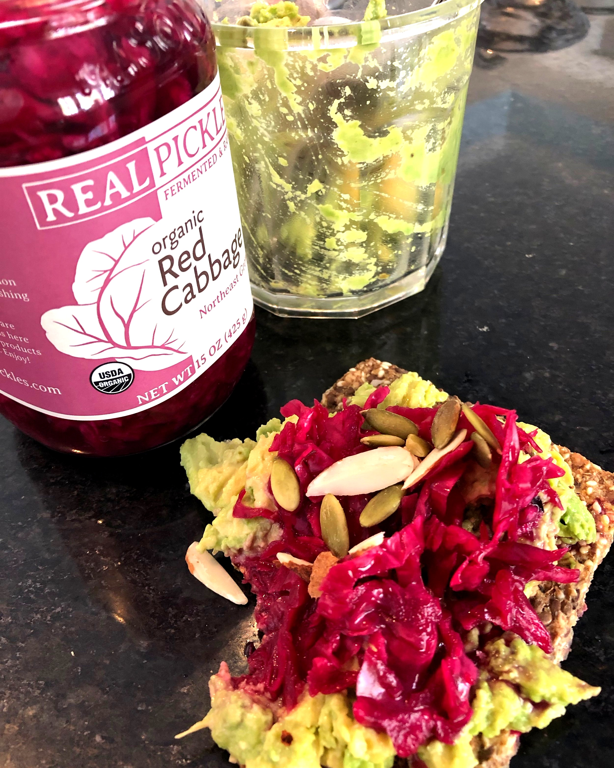 Avocado mash with pickled red cabbage and mixed nuts slathered on a Trader Joe's GF Crispbread is nutritional nirvana!