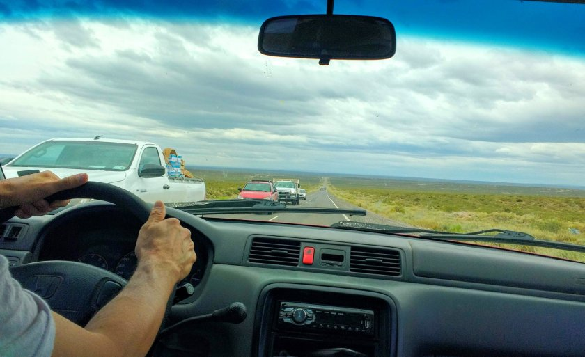 My father driving down one of the straight, endless highways of the Pampas.