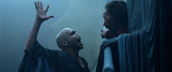 Ralph Fiennes as Voldemort and Daniel Radcliffe as Harry Potter in  Harry Potter and the Goblet of Fire  (2005, Warner Bros.)