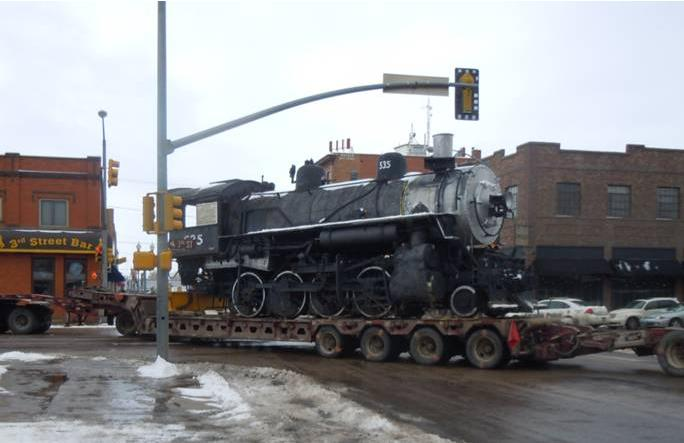 Photo of UP engine 535 rounding the corner of 3rd St. and Grand Ave., Laramie, Wyoming on February 7
