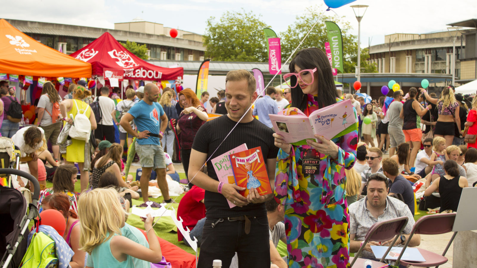 IT'S DRAG QUEEN STORY TIME - Parents will remember the family area at Pride this year attracted more attention than usual, as a succession of six footers crouched in stilettos and leafed through the latest in children's literature…By James Higgins - Bristol 24/7