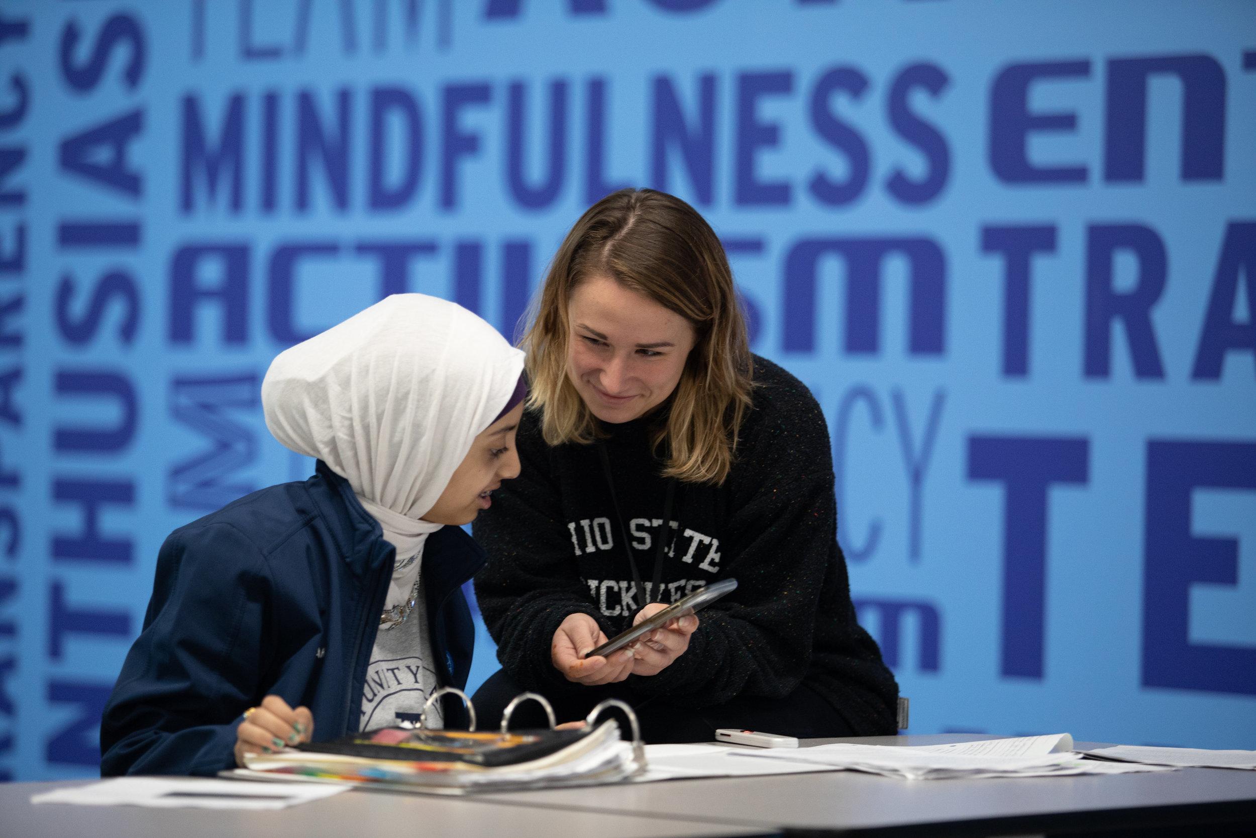 A student at Intrepid College Prep Independence Academy works with Tara Cravens, ESL teacher.