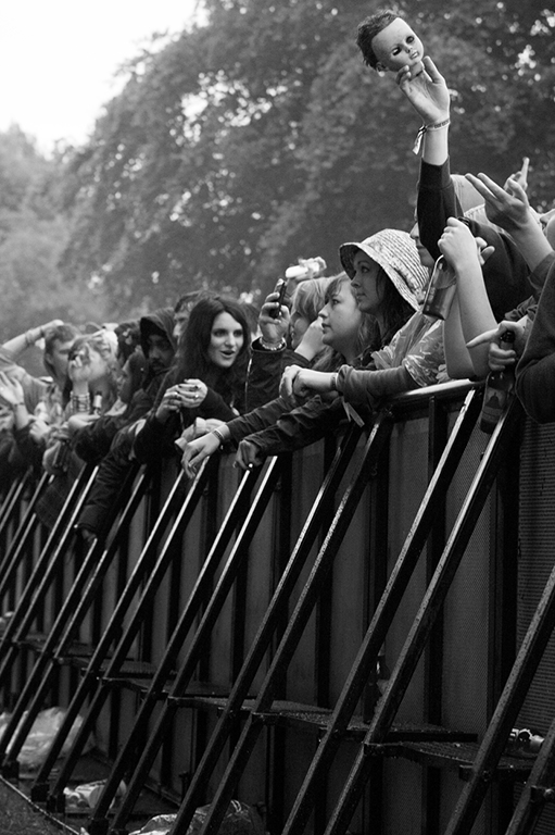 A dolls head is held aloft in the front row outside the main stage. Parklife Festival. Manchester