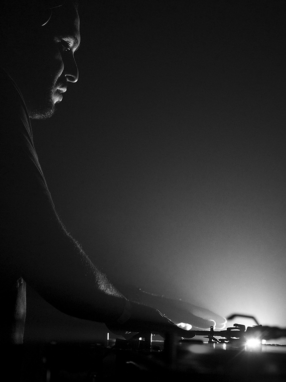 DJ Loco Dice plays vinyls to an a huge crowd. Warehouse Project. Manchester