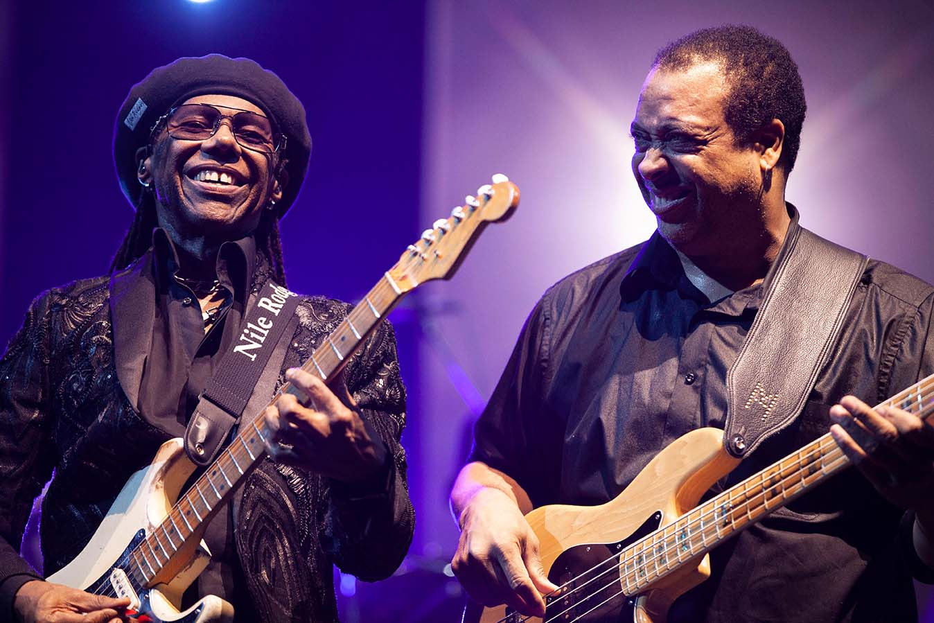 Nile Rodgers and Jerry Bass perform with Chic on stage at the Arena, Manchester