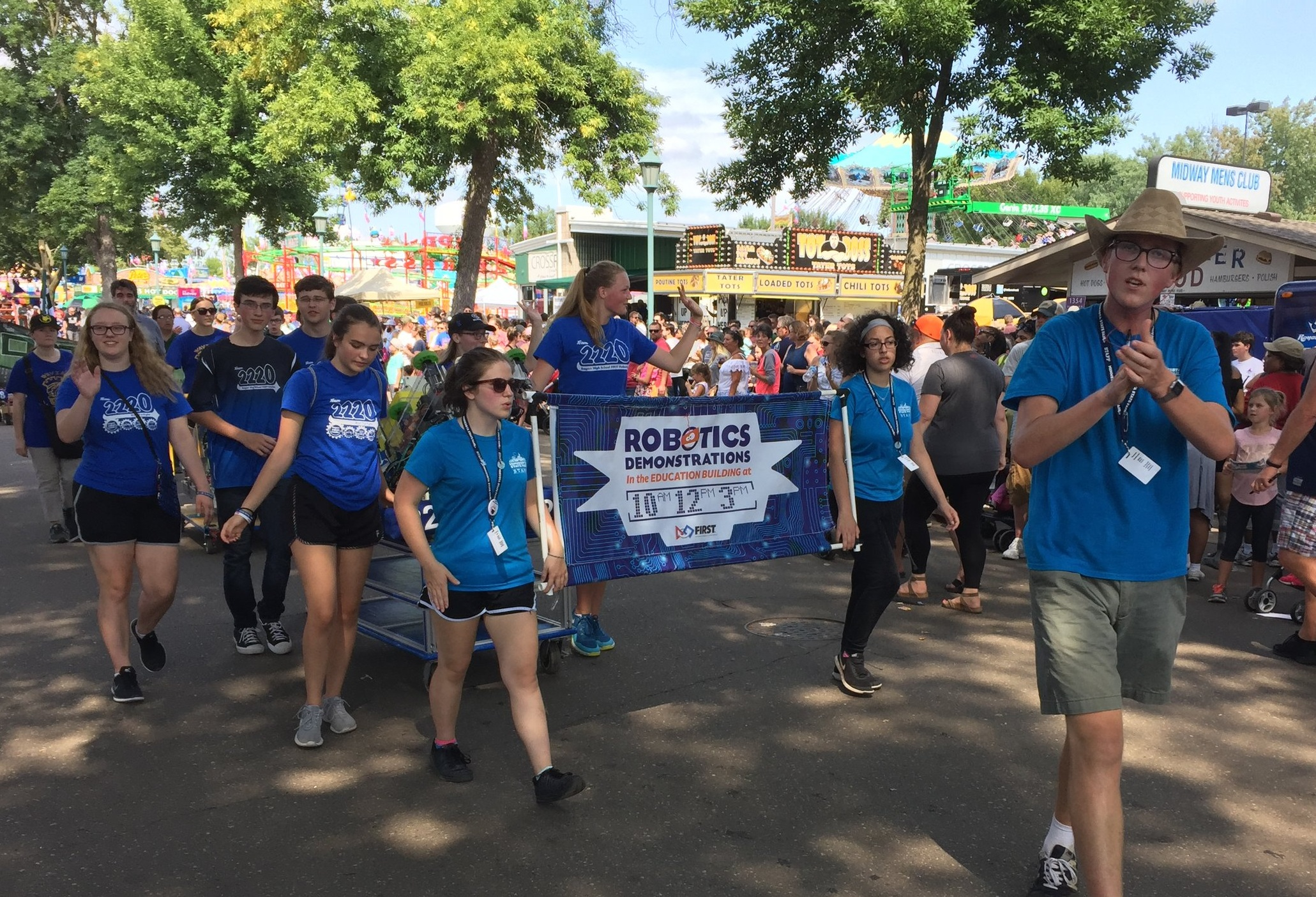 Team 2220 members spreading the message of first at the minnesota state fair.