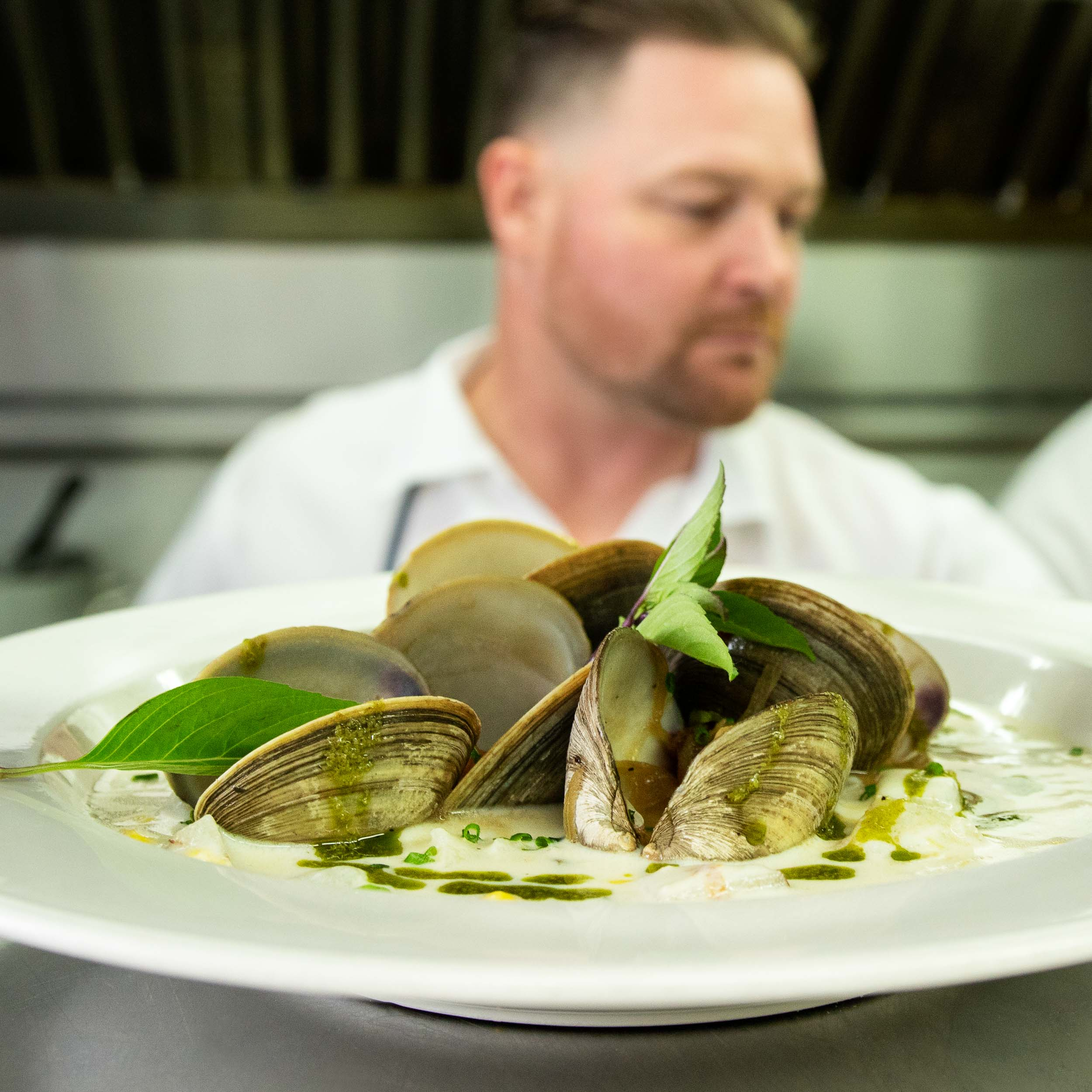 Chef with Mussels in Kitchen