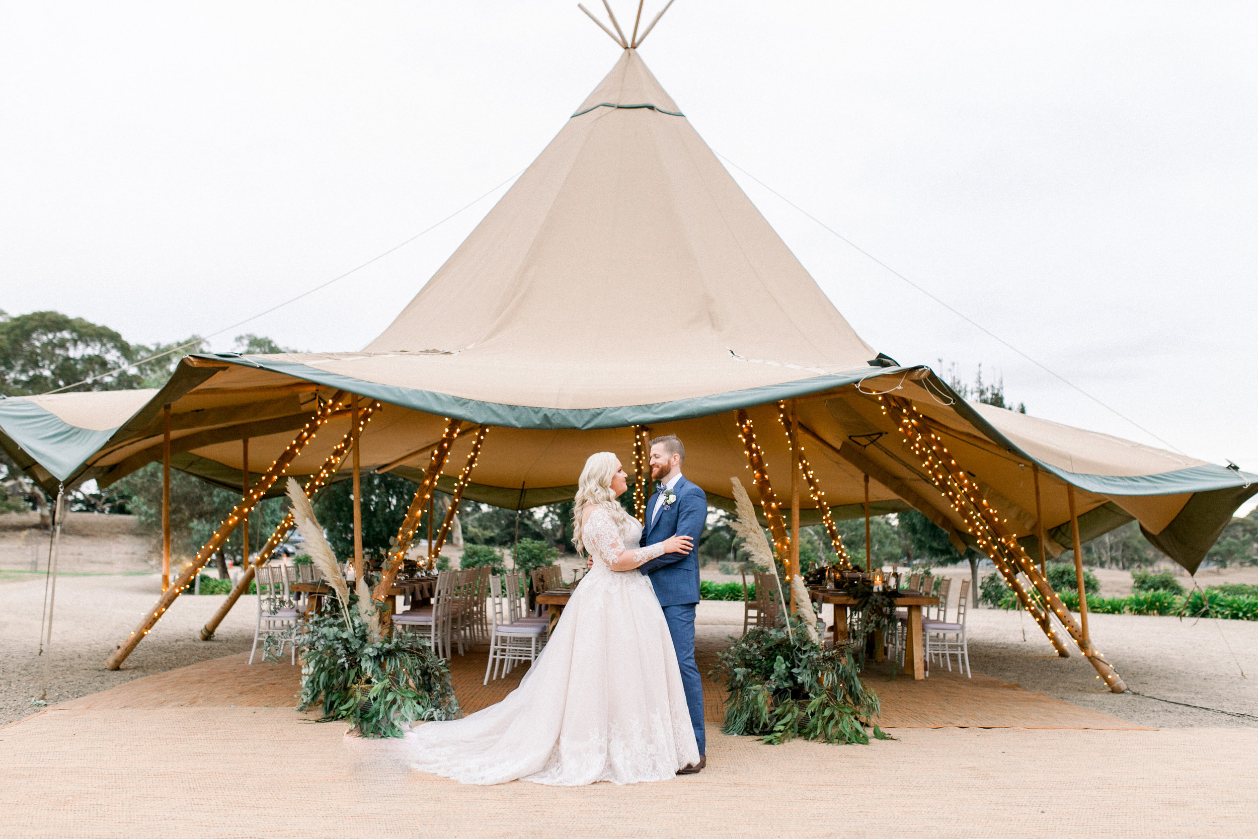 Renee & Tristan on their wedding day with Single Tipi