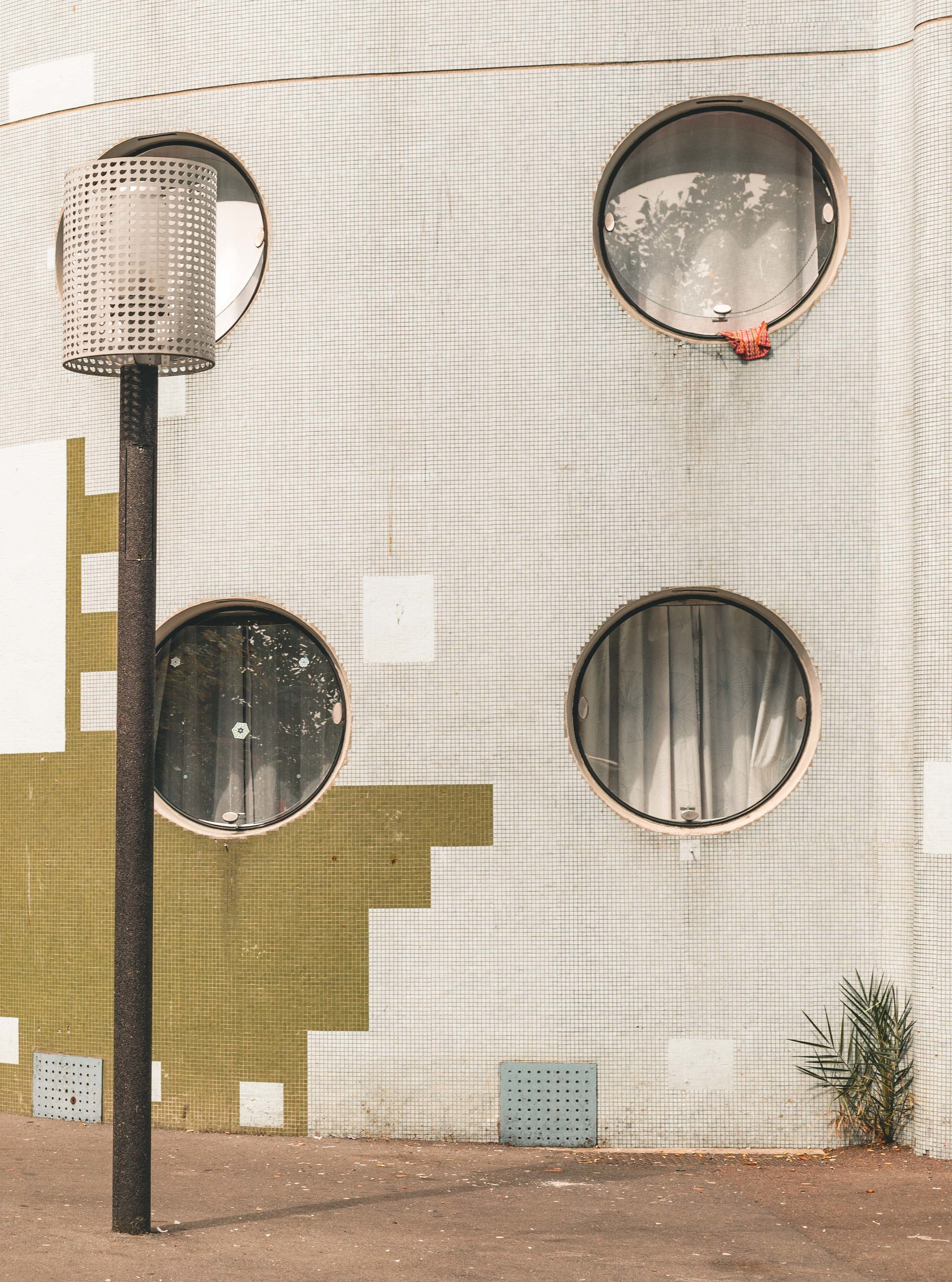 Architecture photograph detail series of Windows of the Tours Aillaud, Nanterre. Circular openings, with mosaic tile frontage. By Daniel Walker Photography