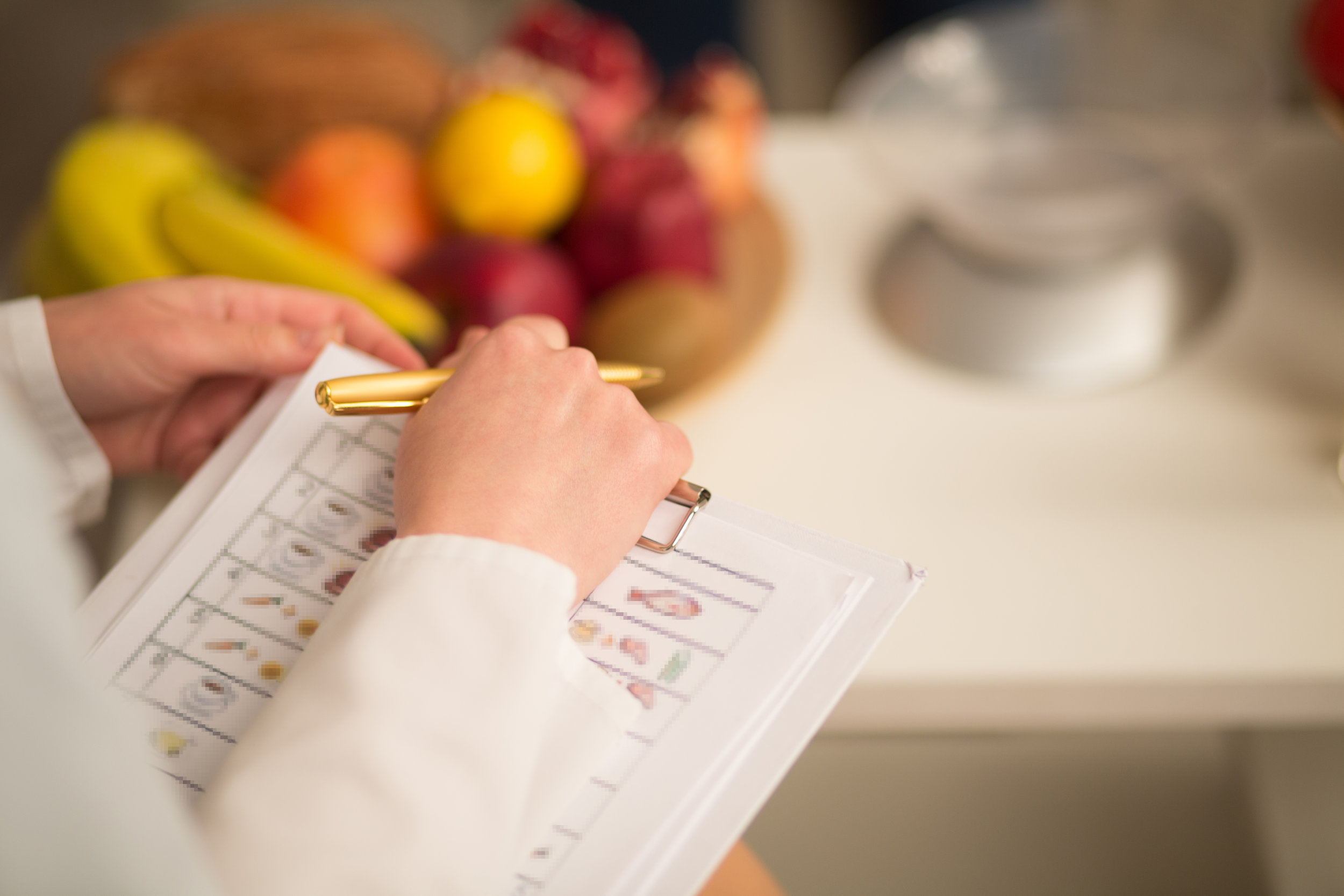 Close up image of note book and pen of dietitian. Healthy life style concept.