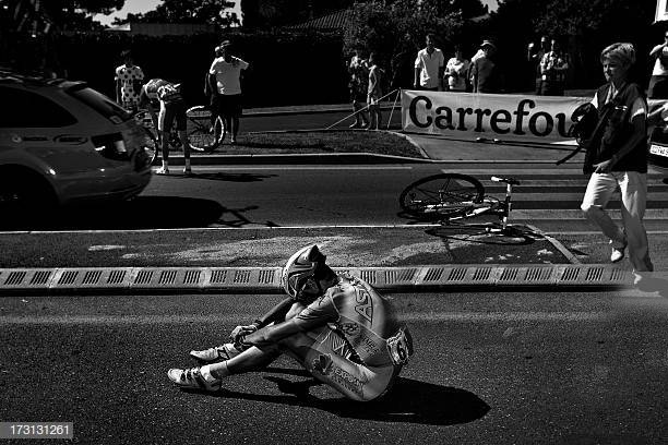 Slovenia's Janez Brajkovic sits on the ground after falling during the 176.5 km sixth stage of the 100th edition of the Tour de France cycling race on July 4, 2013 between Aix-en-Provence and Montpellier, southern France.  AFP PHOTO / JOEL SAGET        (Photo credit should read JOEL SAGET/AFP/Getty Images)