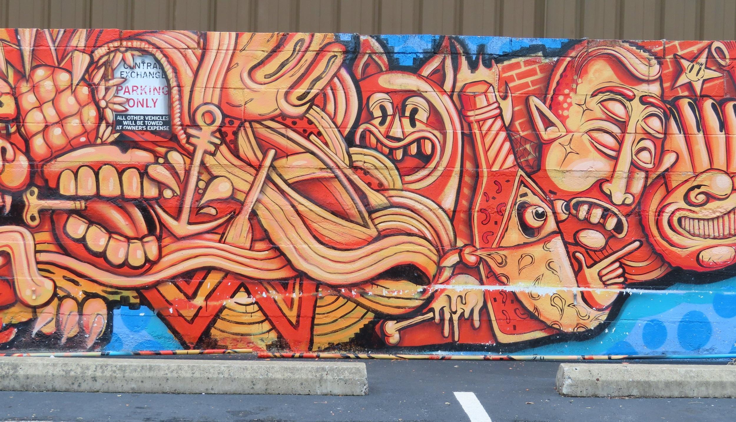 Midtown Memphis mural by  Tooky Berry .tells us Violators Will Be Towed