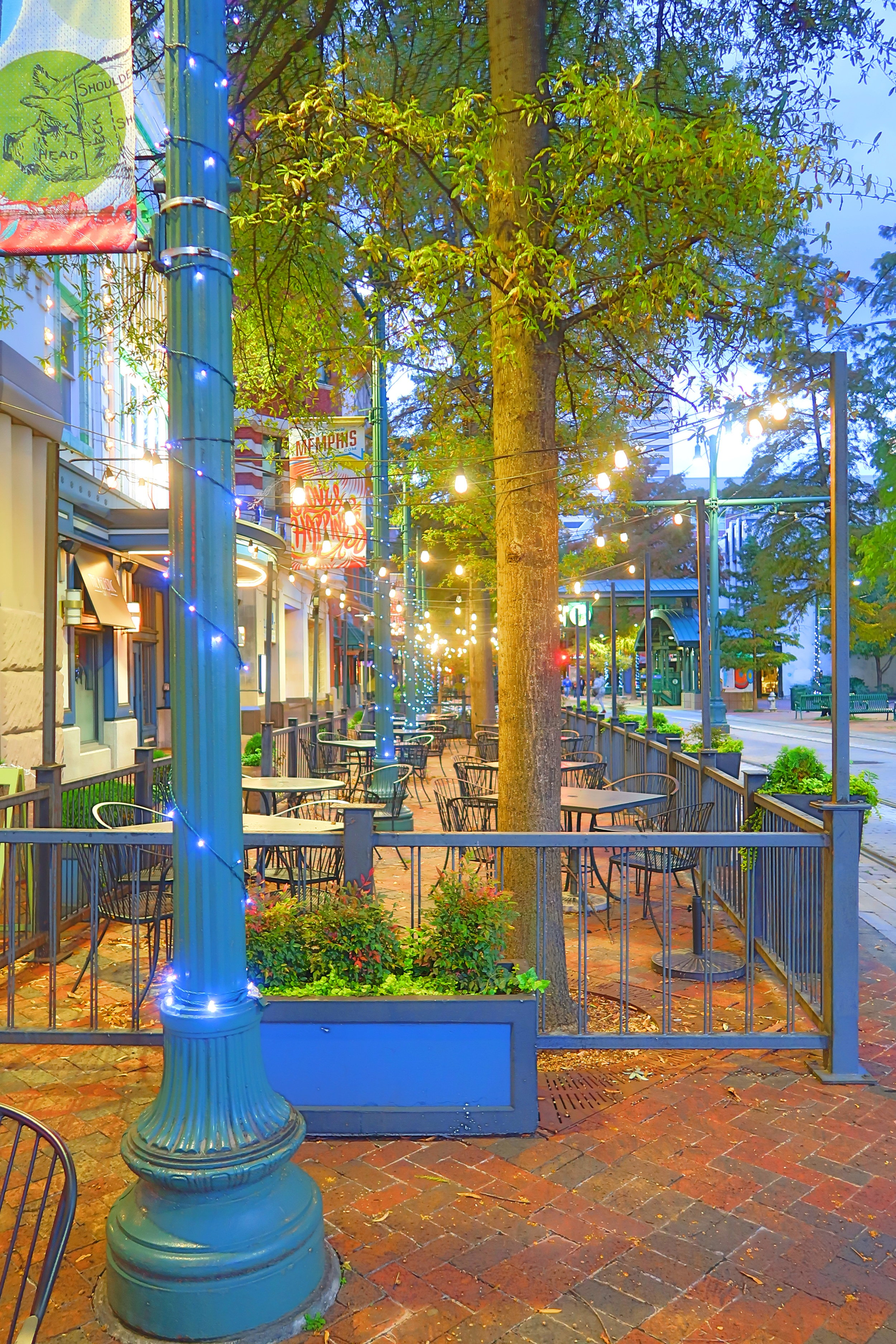 The lights of Main Street in Memphis, TN invite visitors to explore the shops and restaurants.