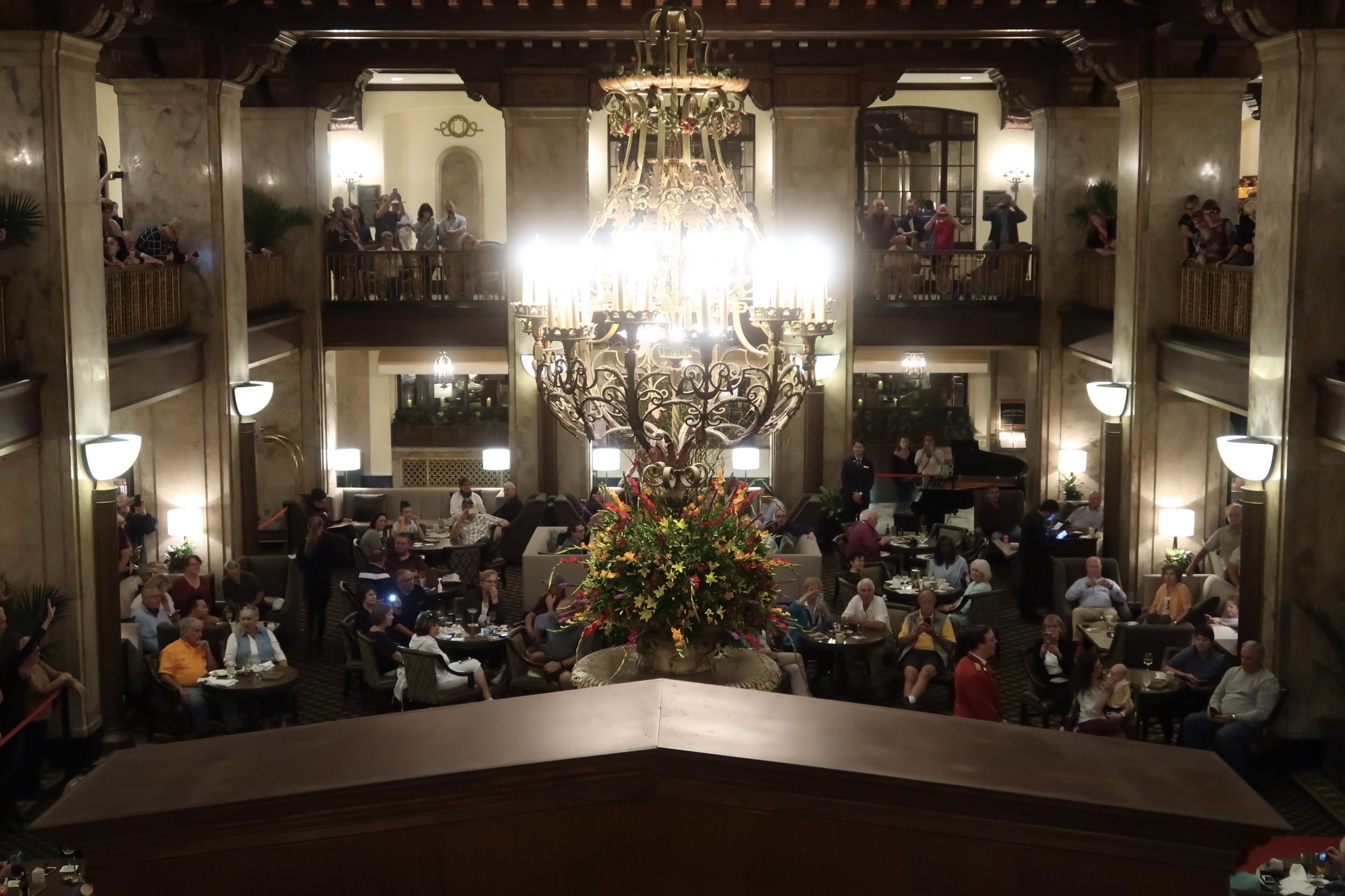 Hundreds of people ring the lobby fountain at the Peabody Hotel, sipping their beverages of choice as they wait for the Duck Parade to begin.