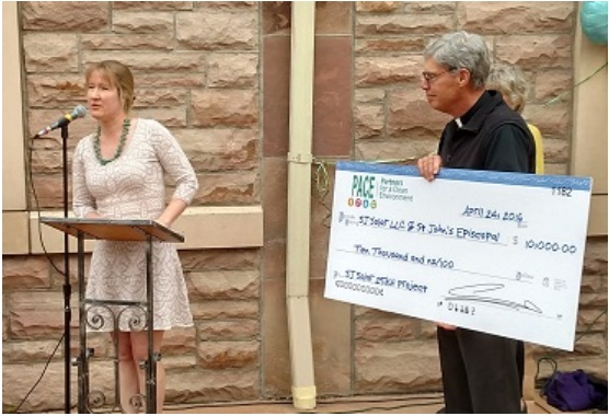 Colin Tomb of Pace awards a check to Fr. Ted of St. John's
