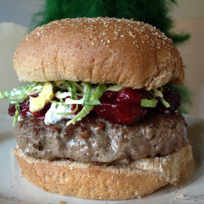 Cranberries, brussel sprouts, and chevre cheese bring the flavors of the holiday into this christmas burger. MMMM