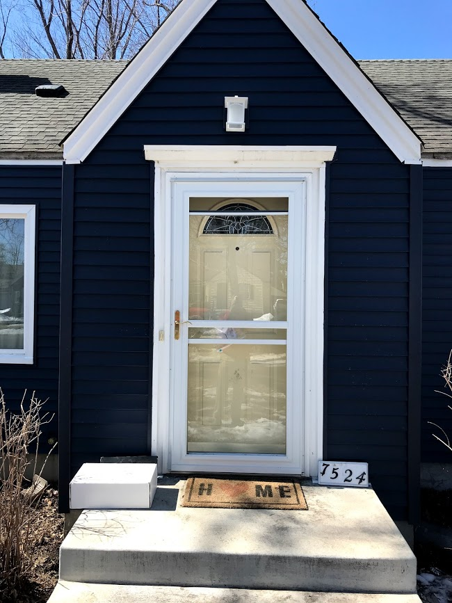 7524 front door with after siding.jpg