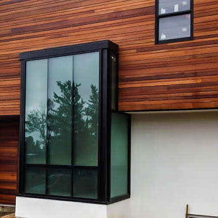 Clad - A material, usually aluminum, which is locked to the outside face of window and door products to provide a durable exterior surface.