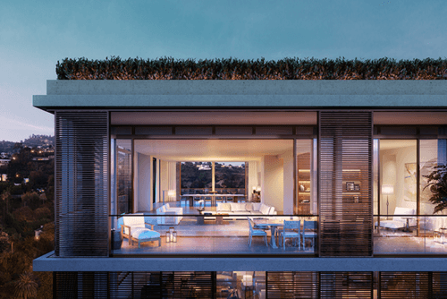 External rendering of West Hollywood Edtion Residences at dusk, with a view into interior rooms.