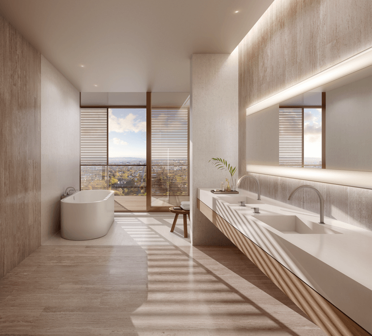Bathroom in a residence at the West Hollywood Edition featuring a tub and two sinks with views of Los Angeles in the background.