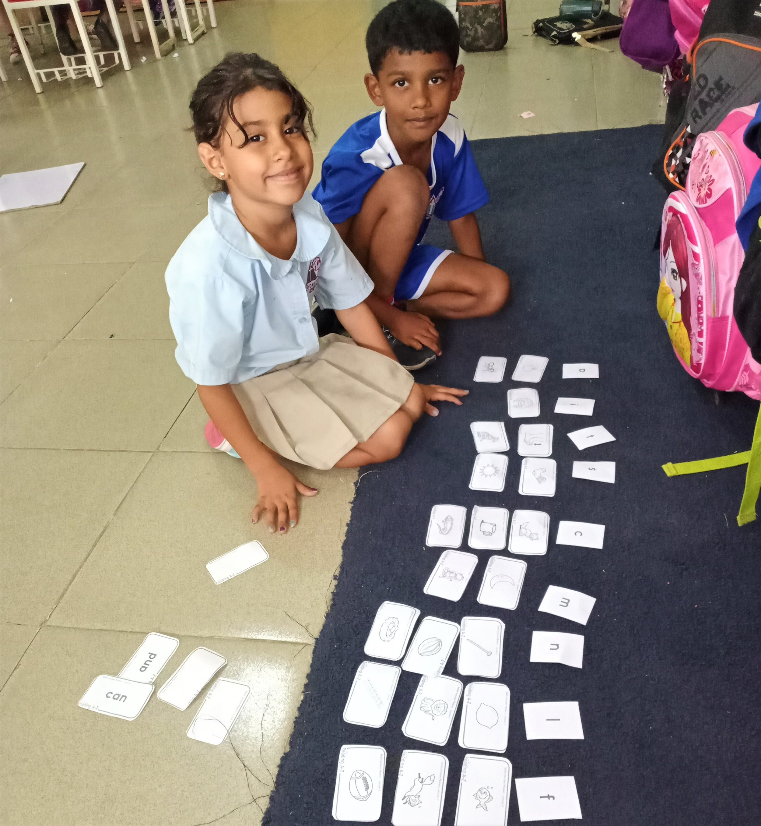 1st grade ESL students having fun, matching sounds with pictures.