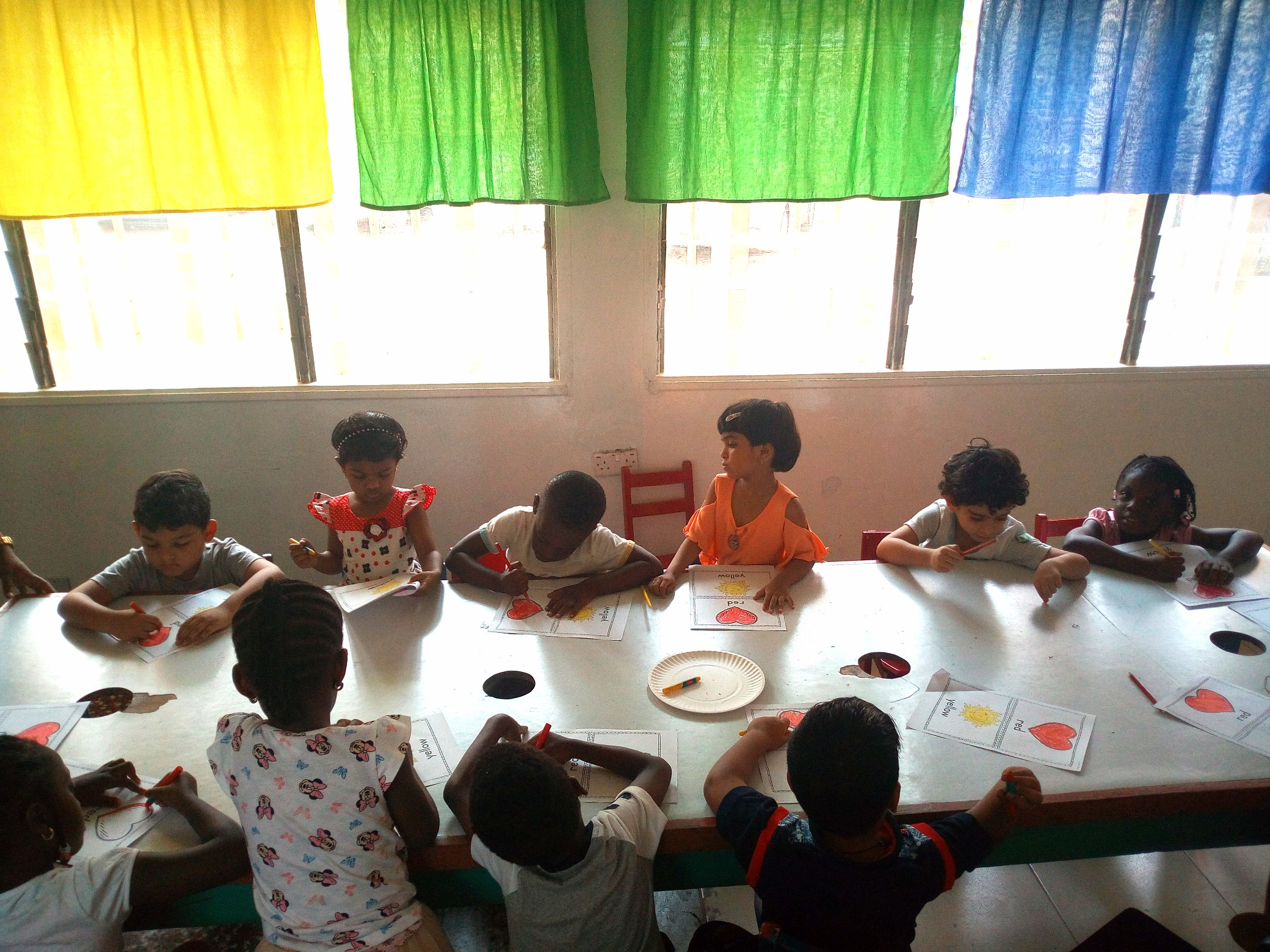 PreKg, working on their book of colors in Art class