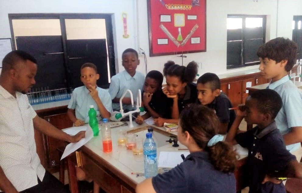 Students of MAD Science Club utilized their observation skills to identify how different indicators are used to determine if a solution is acid or base.