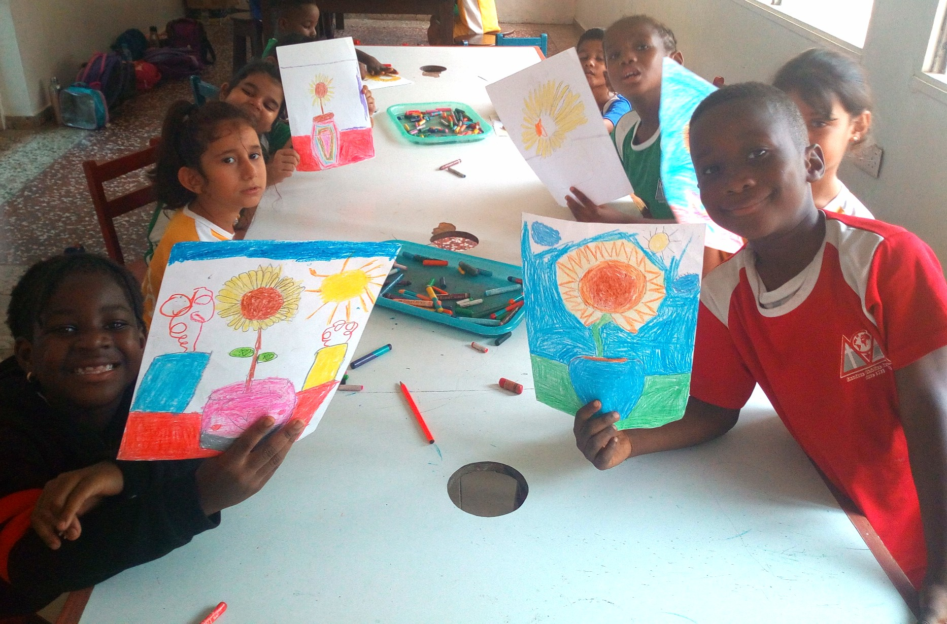 "First graders drew their version of ""Sunflowers"" by Vincent van Gogh in art class."