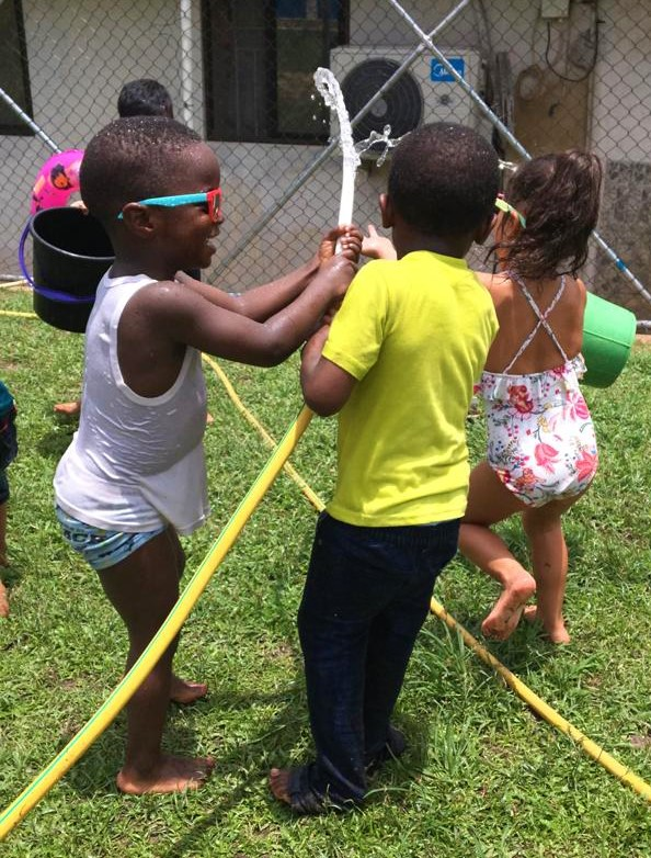 Nursery students learning about weather in Science class by enjoying a sunny day and cool water play!