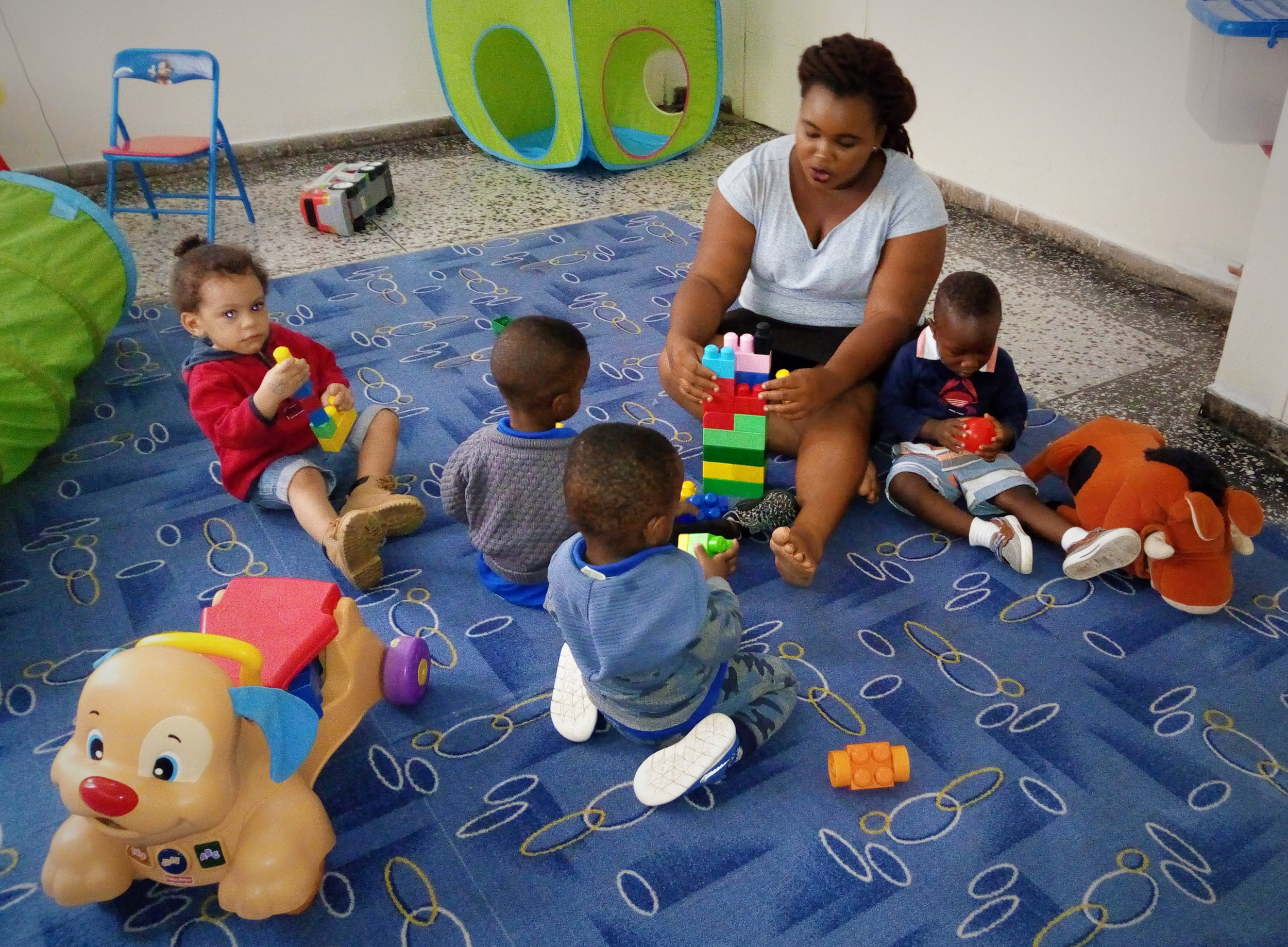 Working with manipulatives in Creche.