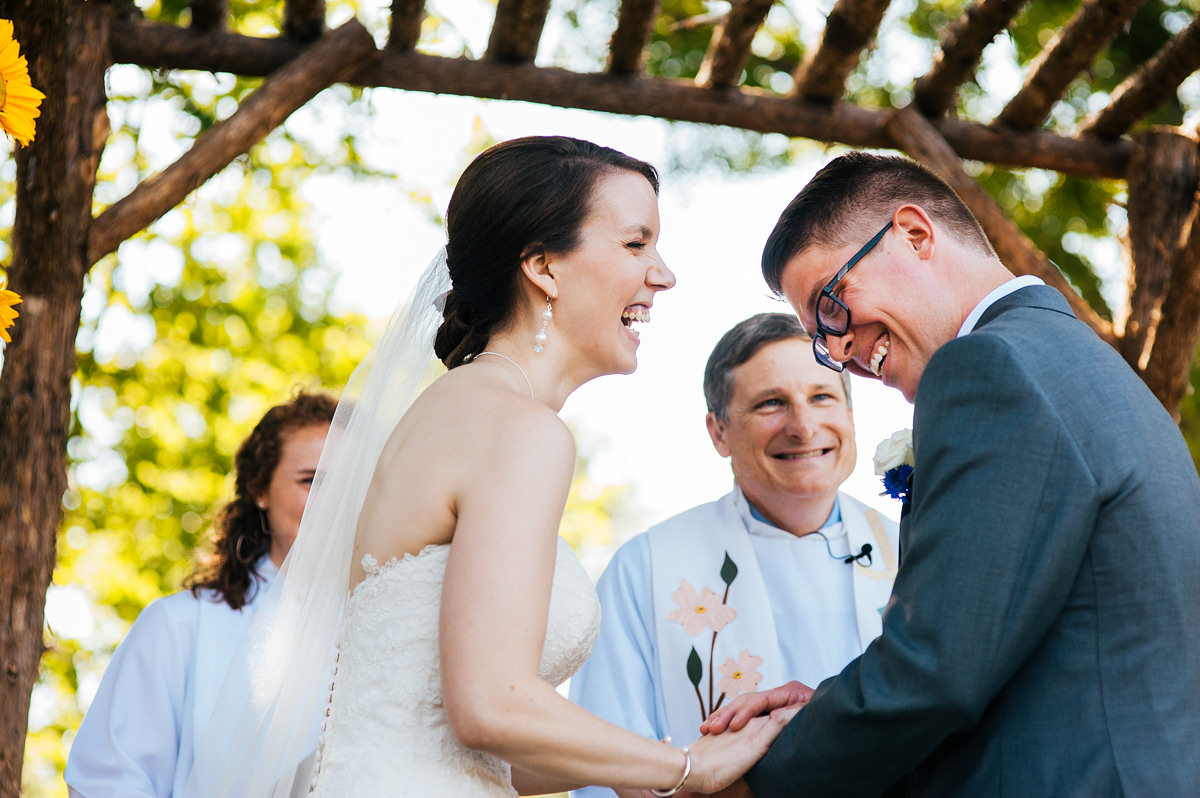 08-bride-groom-joyful-moment-laughing-farm-wedding-ceremony.jpg