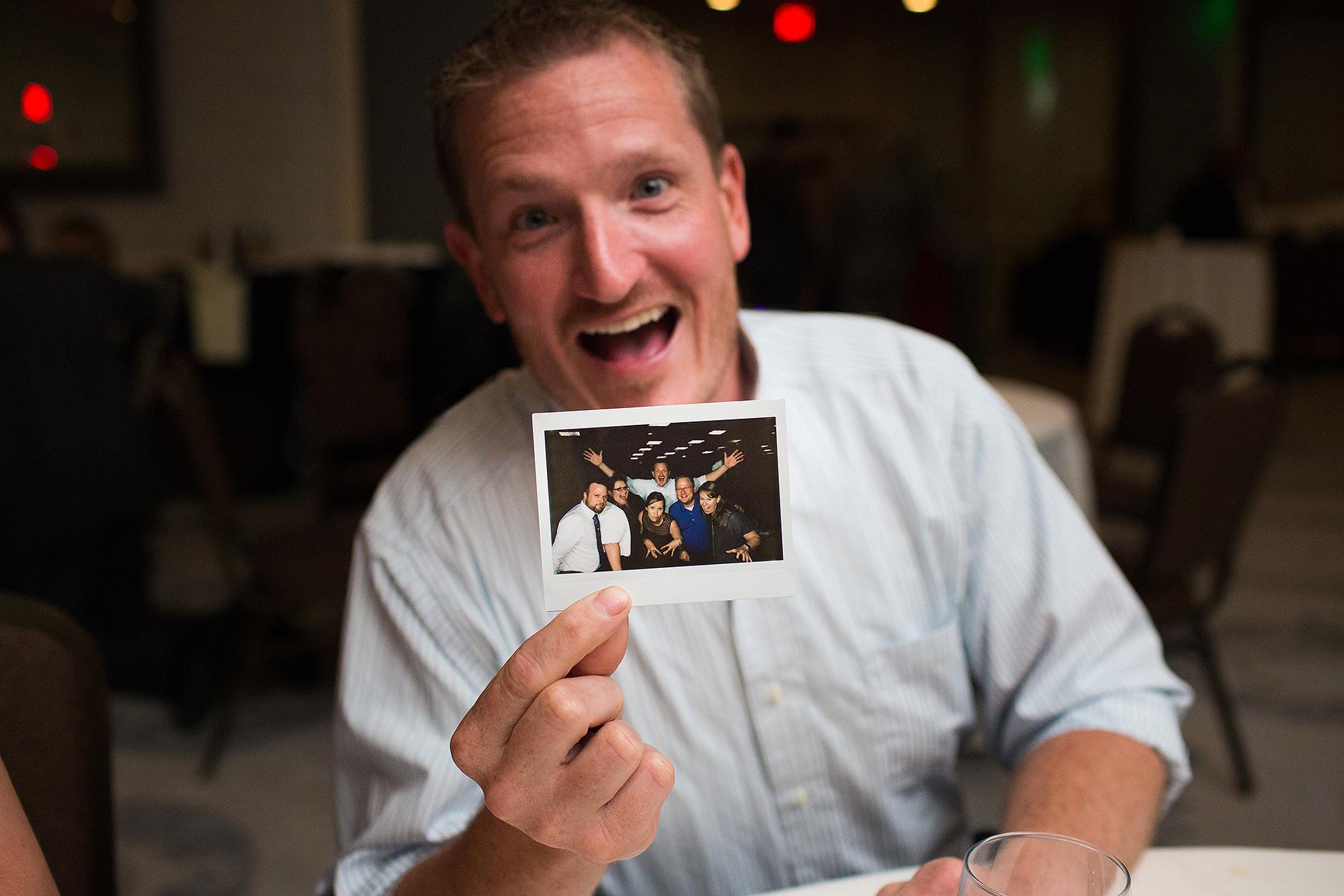 8-excited-guy-with-sarah-corbett-photography-polaroids.jpg