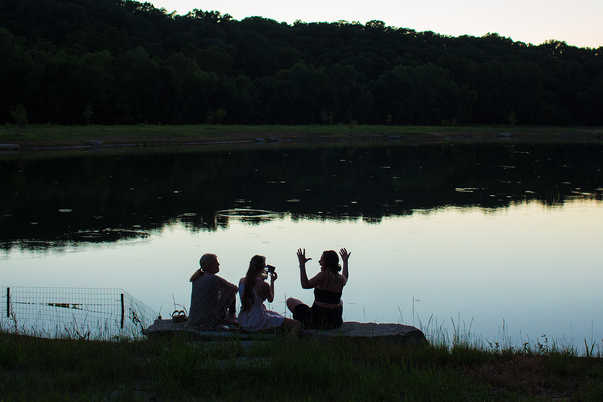 12-three-friends-sitting-by-lake-sarah-corbett-photography-polaroids.jpg