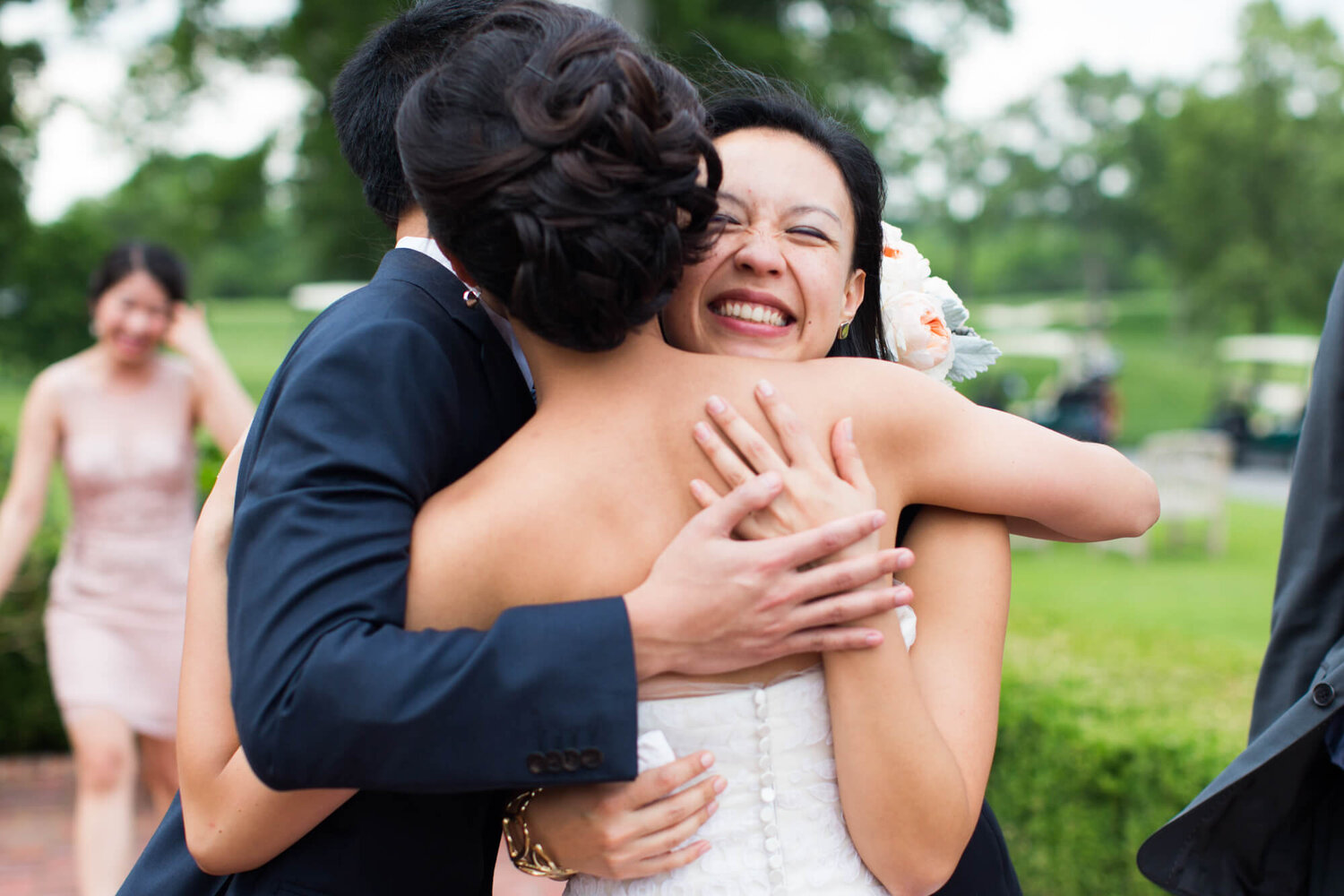 01-old-warson-st-louis-wedding-guests-hugging-bride.jpg