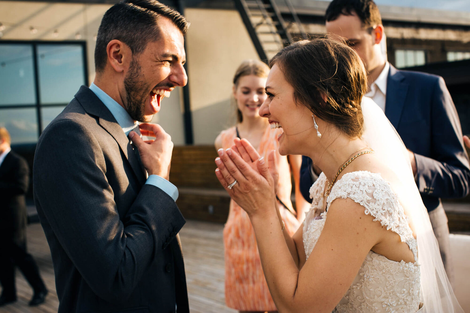 19-bissingers-chocolate-factory-st-louis-mo-wedding-patio-bride-laughing.jpg