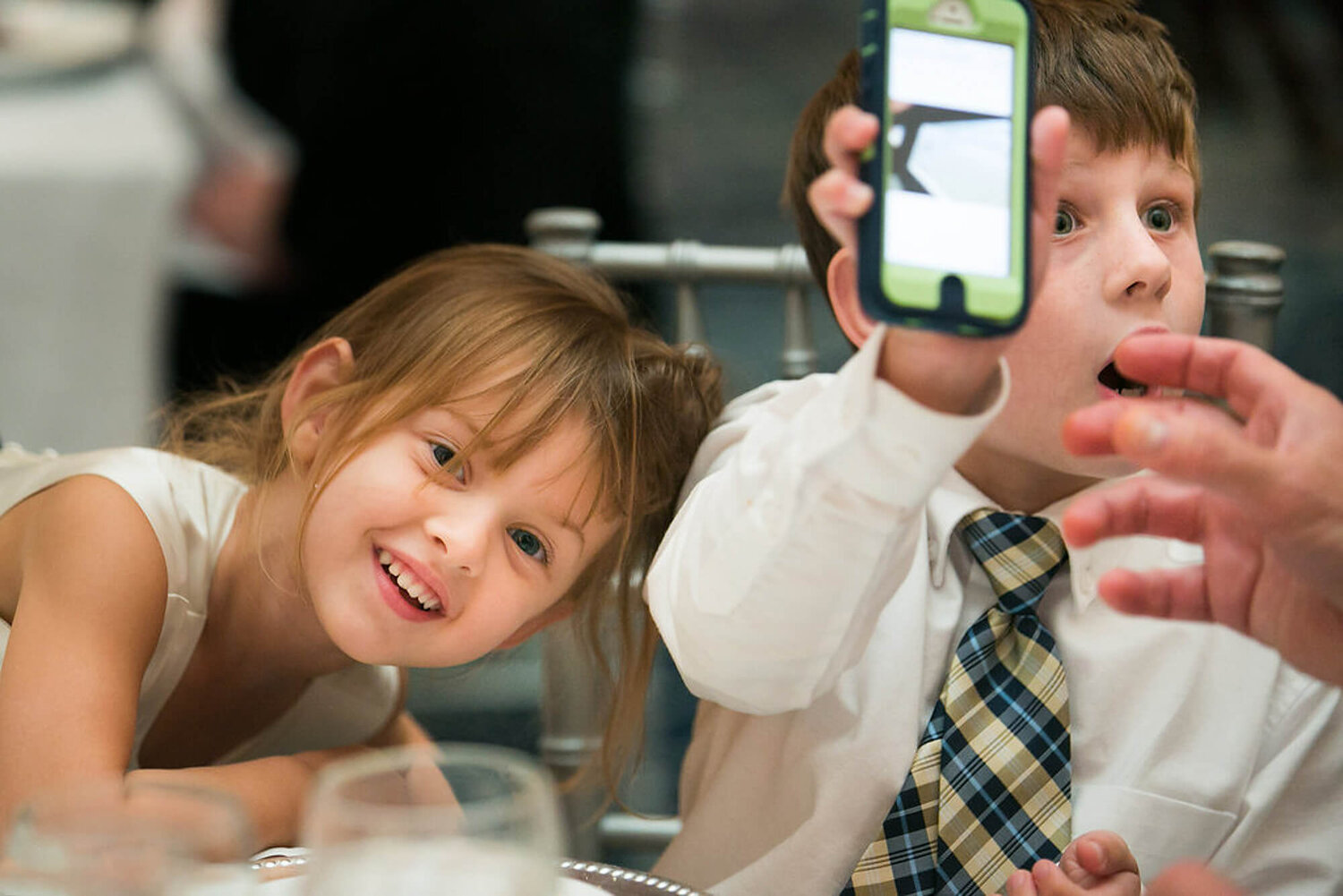40-st-louis-kids-wedding-reception-cell-phone.jpg