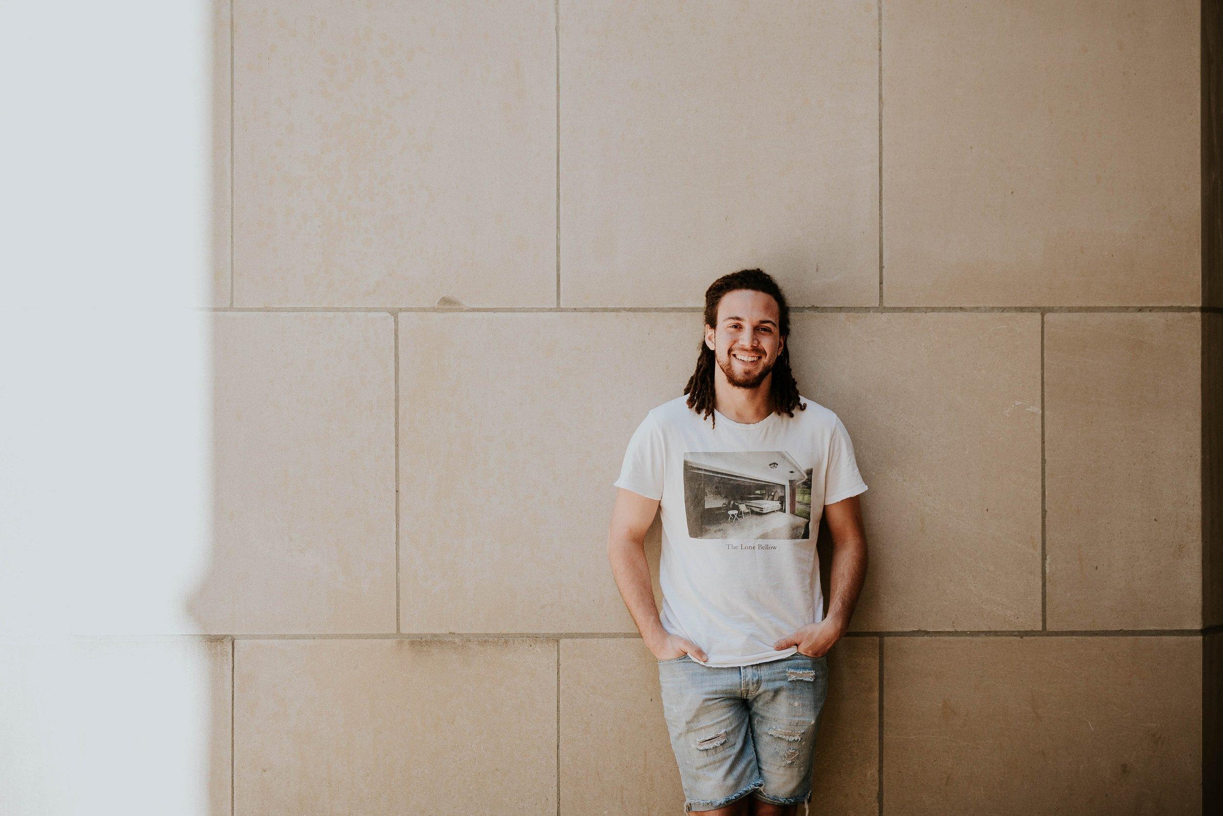 man against wall smiling.jpg