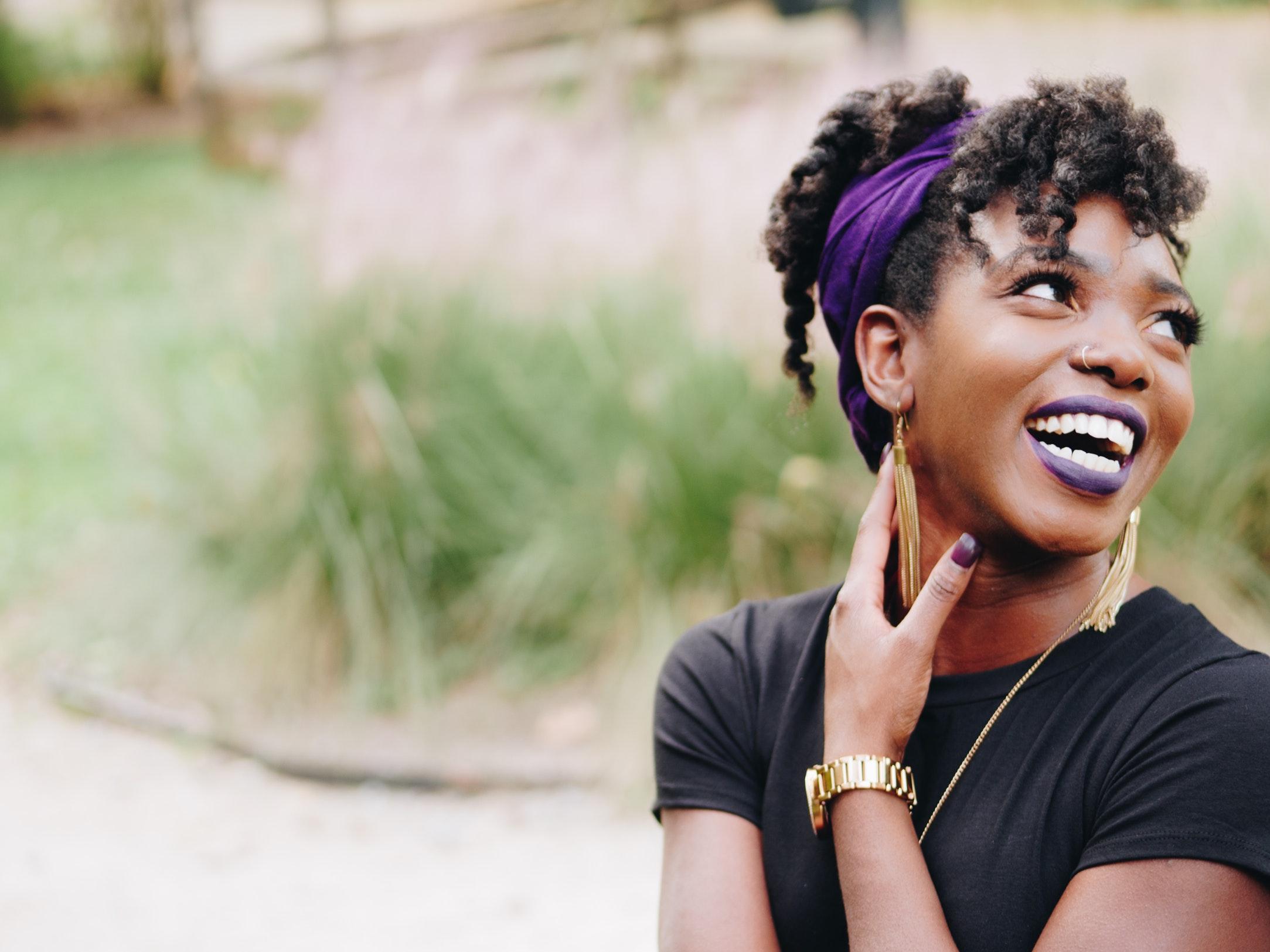 woman smiling purple lipstick.jpg