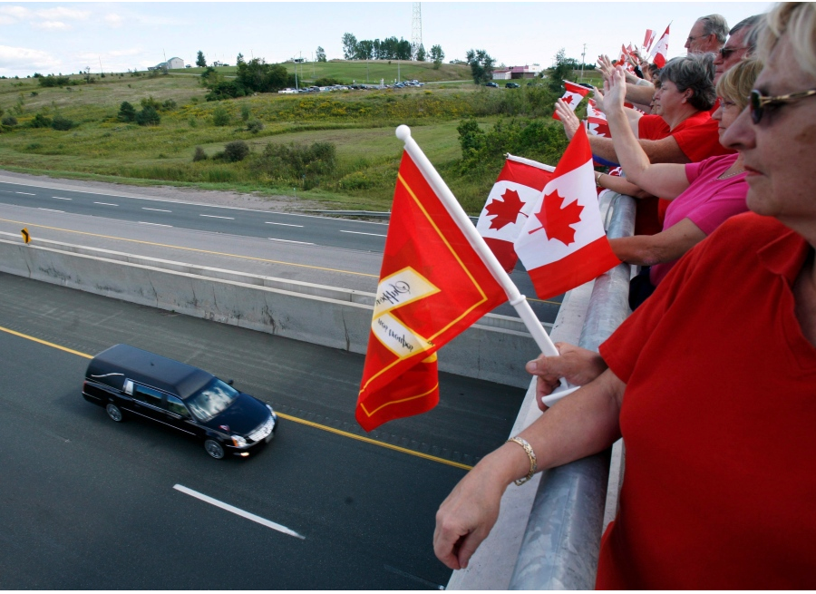 People stand along an overpass above the Highway of Heroes in this undated file photo. - CTV NEWS