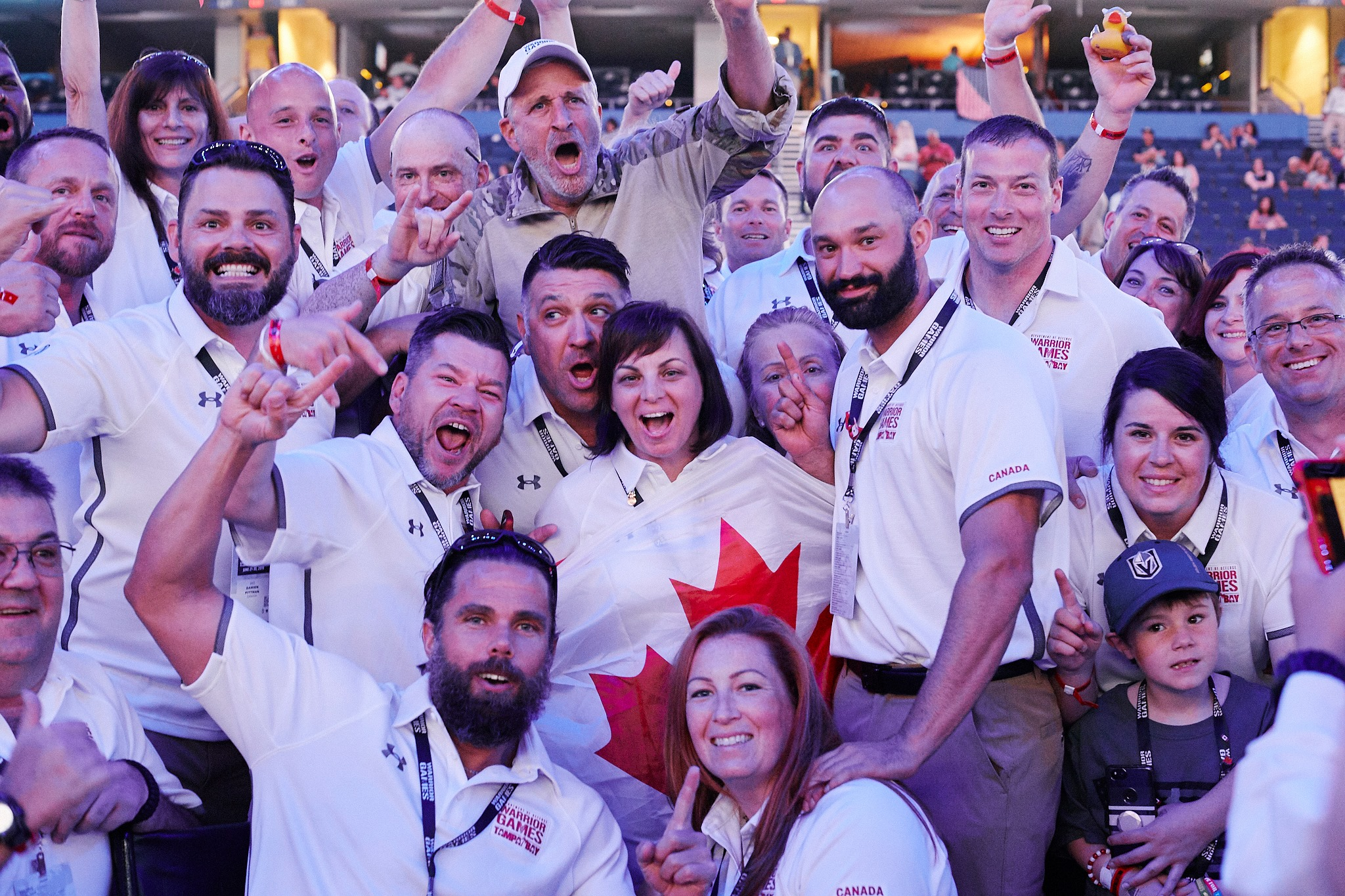 Comedian and former talk show host Jon Stewart (centre, top row) poses for a group photo with Team Canada athletes during the Warrior Games in Tampa, Fla. Photo credit: Soldier On