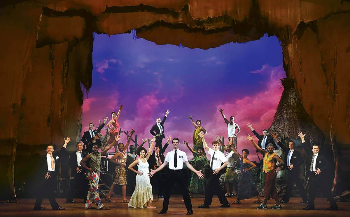 Ryan Bondy, Zahra Newman, Nyk Bielak and company in The Book of Mormon.  ©  Jeff Busby.
