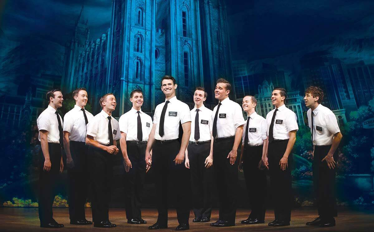 Ryan Bondy, A.J. Holmes and company in The Book of Mormon.  ©  Jeff Busby.