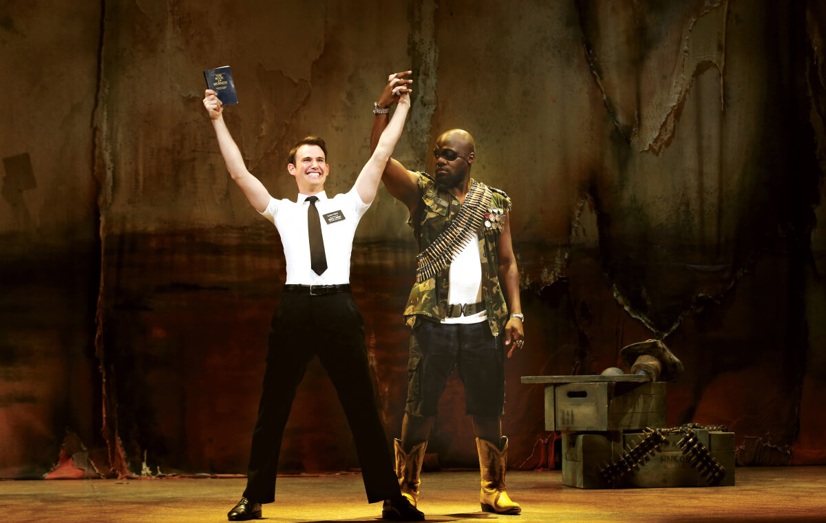 Ryan Bondy and Augustin Aziz Tchantcho in The Book of Mormon.  ©  Jeff Busby.