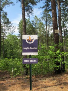 (4) Clean Jordan Lake's Adopt-A-Shoreline sign just after installation in April