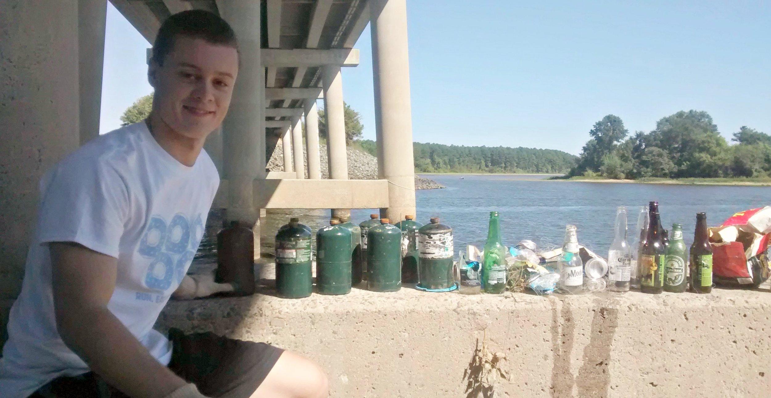 Adam under bridge w trash (2)