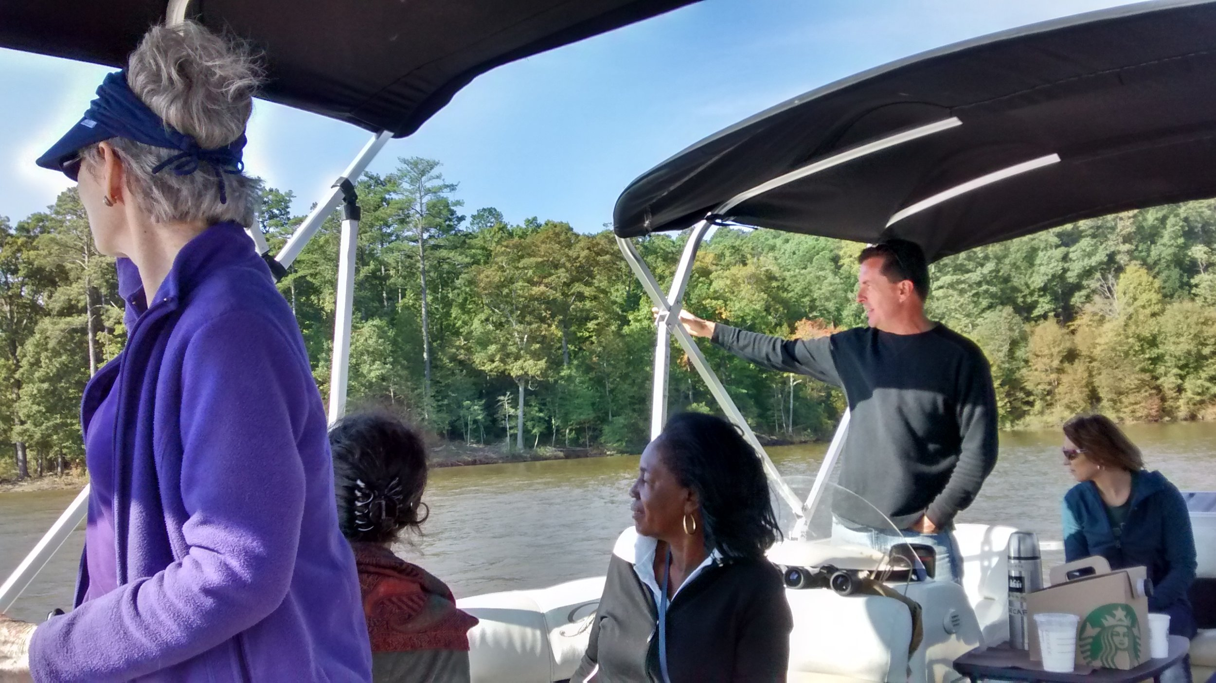 Photo 2-Captain Don of Triangle Boat Tours pointing out features to Jordan Lake (2)