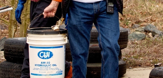 CJL event Mar. 16, 2013  Fran DiGiano foreground carrying pail of lubricant oil(620x800).jpg
