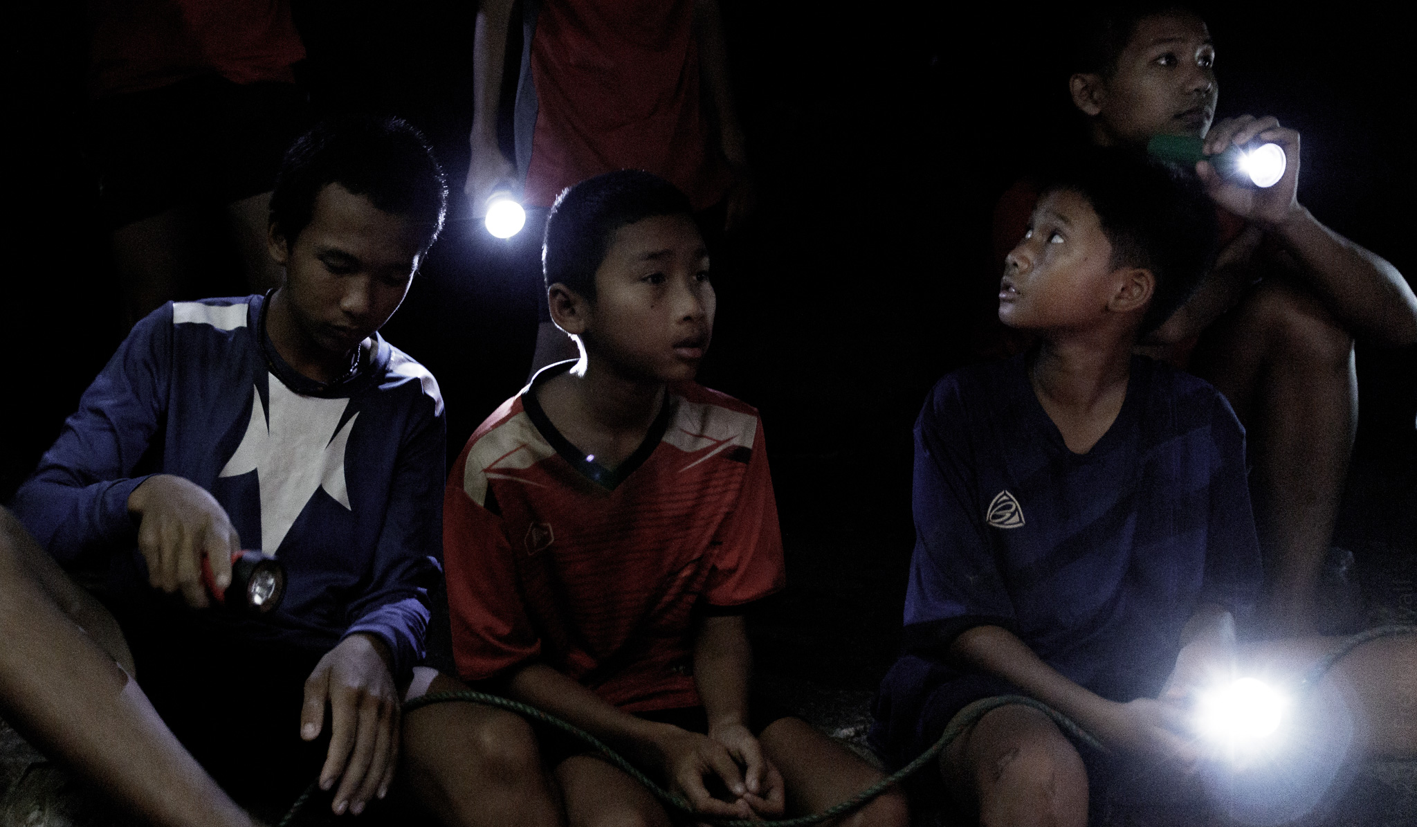 12 boys and their football coach get trapped in a cave in Northern Thailand. Photo (c) Fredrik Divall